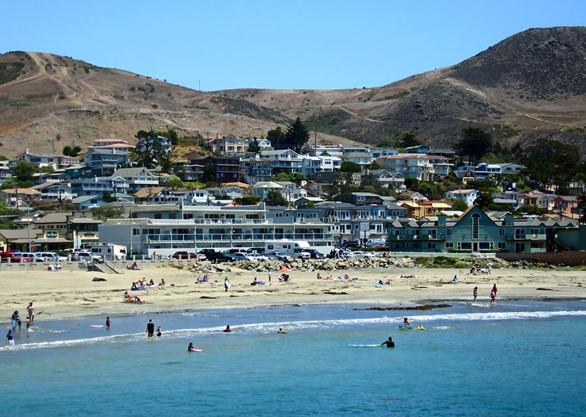 Cayucos looking from the pier towards the town - Photo by Adam Sofen